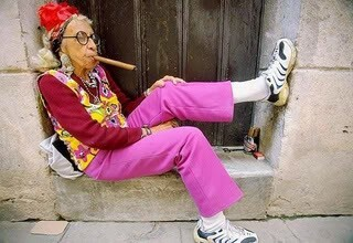 Picture of fashionable old lady smoking a cigar.